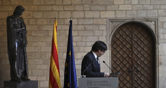 Catalan President Carles Puigdemont turns away after making a statement at the Palau Generalitat in Barcelona, Spain,Thursday Oct. 26, 2017. (AP Photo)