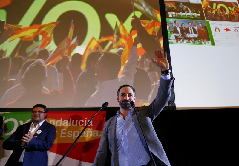 Spain's far-right VOX party leader Santiago Abascal waves next to regional candidate Francisco Serrano as they celebrate results after the Andalusian regional elections in Seville, Spain December 2, 2018. (Reuters Photo)