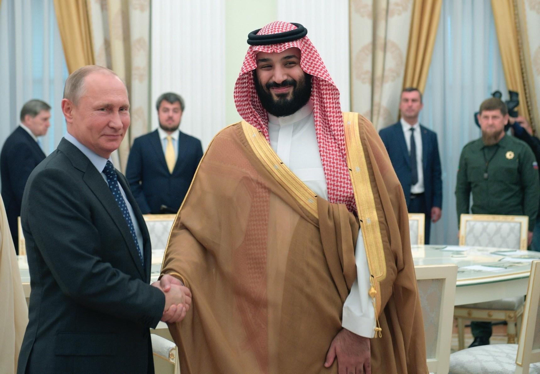 Russian President Vladimir Putin shakes hands with Saudi Arabia Crown Prince Mohammed bin Salman during their meeting in Moscow, June 14.