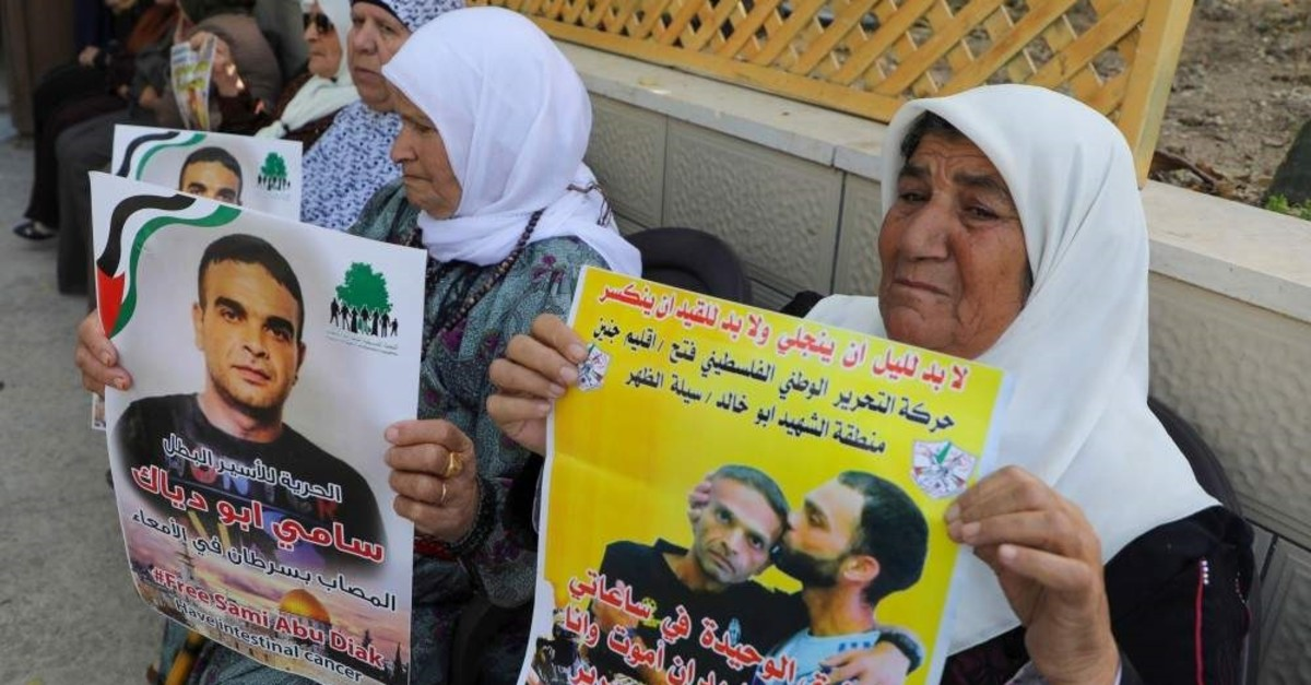 Relatives of Palestinian prisoner Sami Abu Diyak mourn at his house in Saylat al-Dahr town, south of Jenin city in the West Bank, on Nov. 26, 2019, after news of his death of cancer while in Israeli custody. (AFP Photo)