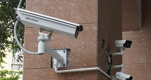 In this July 4, 2018, photo, Hikvision surveillance cameras linked to the local police can be seen at the gateway to a residential block in Fuzhou in southeast China's Fujian province. (AP Photo)