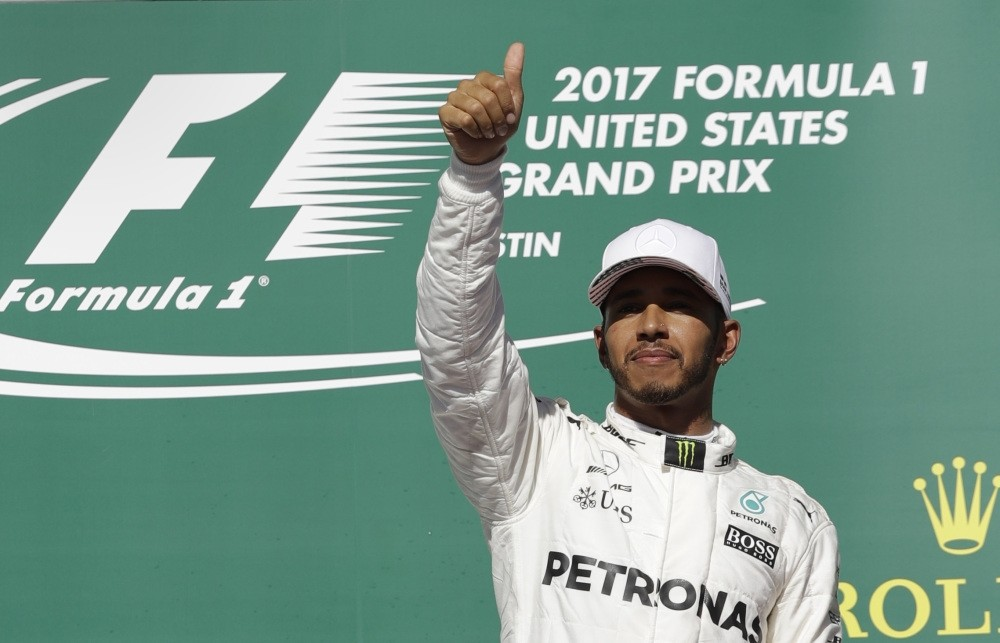 Mercedes driver Lewis Hamilton celebrates his win in the Formula One U.S. Grand Prix auto race at the Circuit of the Americas on Oct. 22, in Austin.
