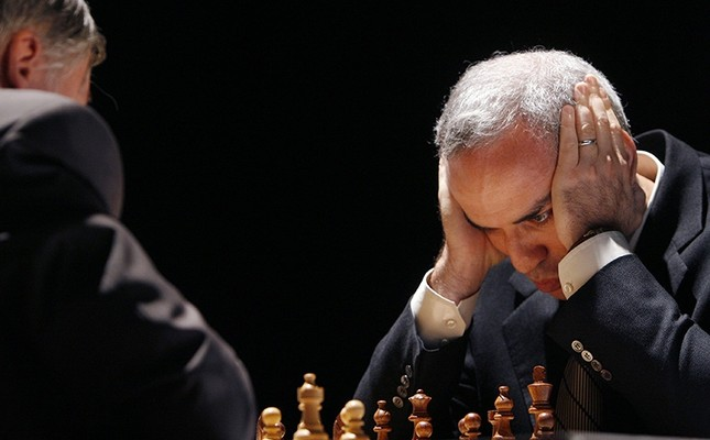 In this Tuesday, Sept. 22, 2009 file photo, former chess world champion Garry Kasparov, right, and Anatoly Karpov, left, play an exhibition rematch in Valencia, Spain. (AP Photo)