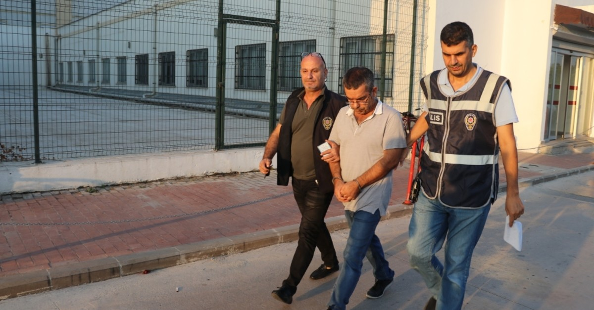 Police escort a suspect captured in an operation in the southern city of Adana, Sept. 13, 2019.