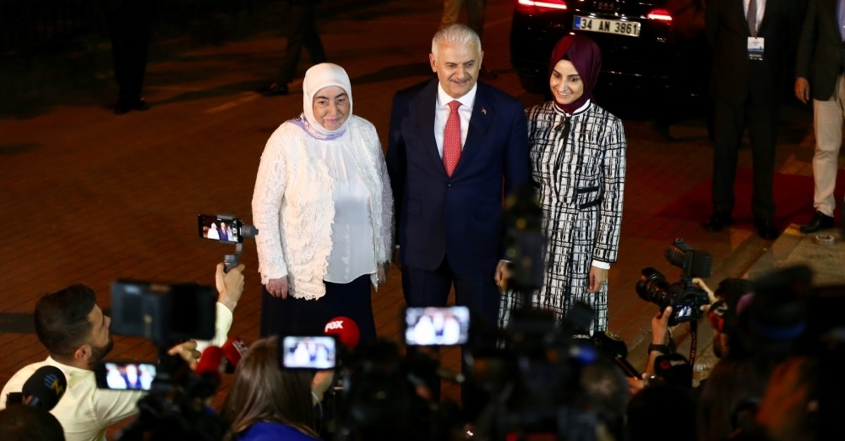 The AK Party's Istanbul mayoral candidate Binali Yu0131ldu0131ru0131m and his family pose for cameras as they arrive for a televised debate with the main opposition CHP's candidate ahead of the June 23 Istanbul elections, Istanbul, June 16, 2019.