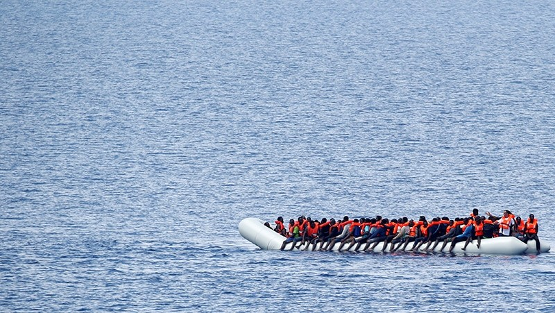 Migrants wait to be rescued by ,Save the Children, NGO crew in the Mediterranean sea off Libya coast, June 18, 2017. (Reuters Photo)