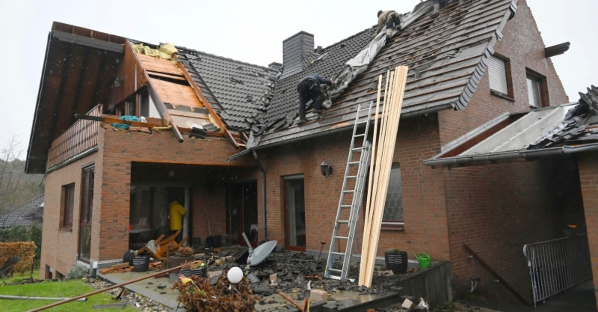 Roofer work on a damaged building in Roetgen, western Germany, Thursday, March 14, 2019 after it was hit by a twister the day before. (DPA Photo)