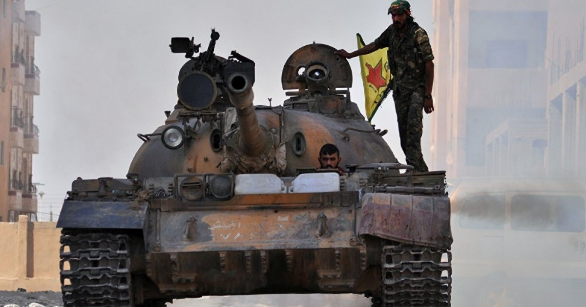 File photo shows YPG militants in a tank.