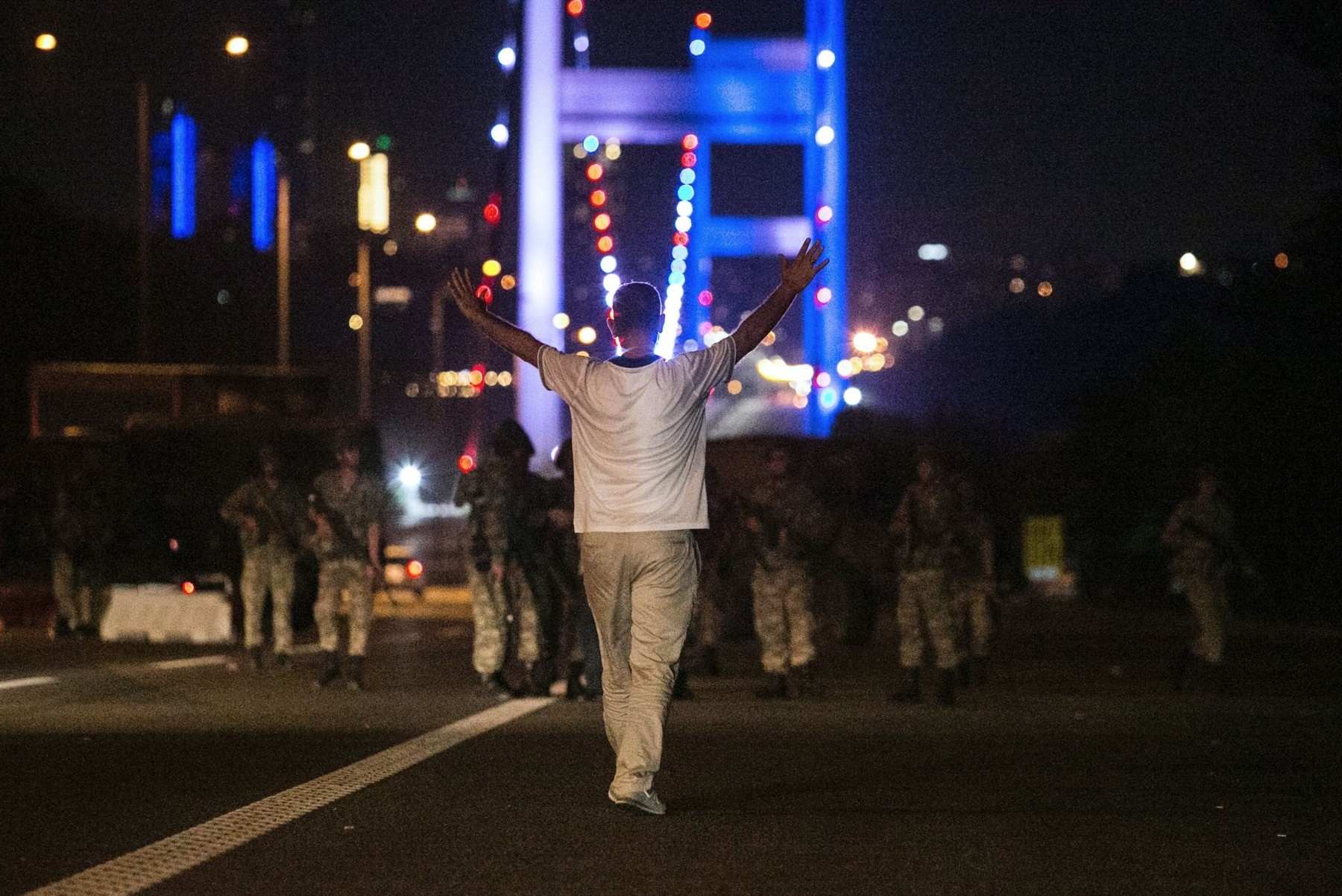 A man approaches putschist soldiers in front of the July 15 Martyrsu2019 Bridge in Istanbul on July 15, 2016. Istanbul was at the heart of resistance against putschists loyal to FETu00d6.