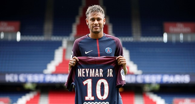 Neymar Jr poses with the club shirt. REUTERS Photo