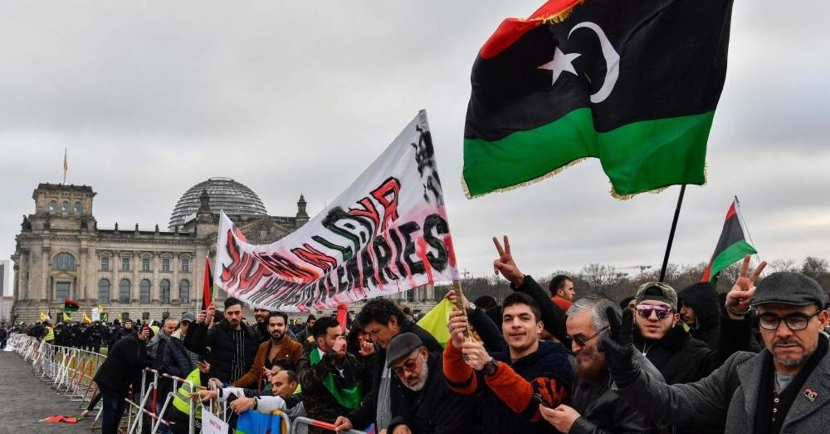 Protesters hold a banner reading ,Stop war in Libya, Haftar and mercenaries, during a protest in front of the Reichstag building during the Peace summit on Libya at the Chancellery in Berlin, Jan.19, 2020.  (AFP)