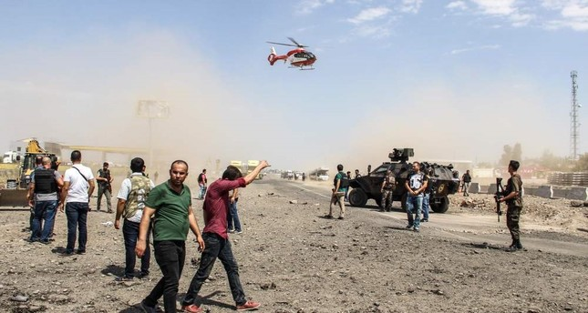 An ambulance helicopter landing as Turkish police officers and rescue personnel search the site of a car bomb explosion by the PKK on Aug. 15 in Turkey's southeastern city of Diyarbakır. (AFP Photo)