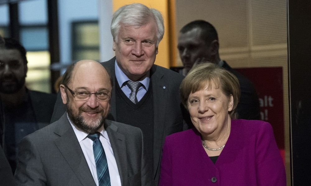SPD leader Schulz (L), CSU leader Horst Seehofer (C) and CDU leader Chancellor Merkel arrive for coalition negotiations to form a government, Berlin, Feb. 2.