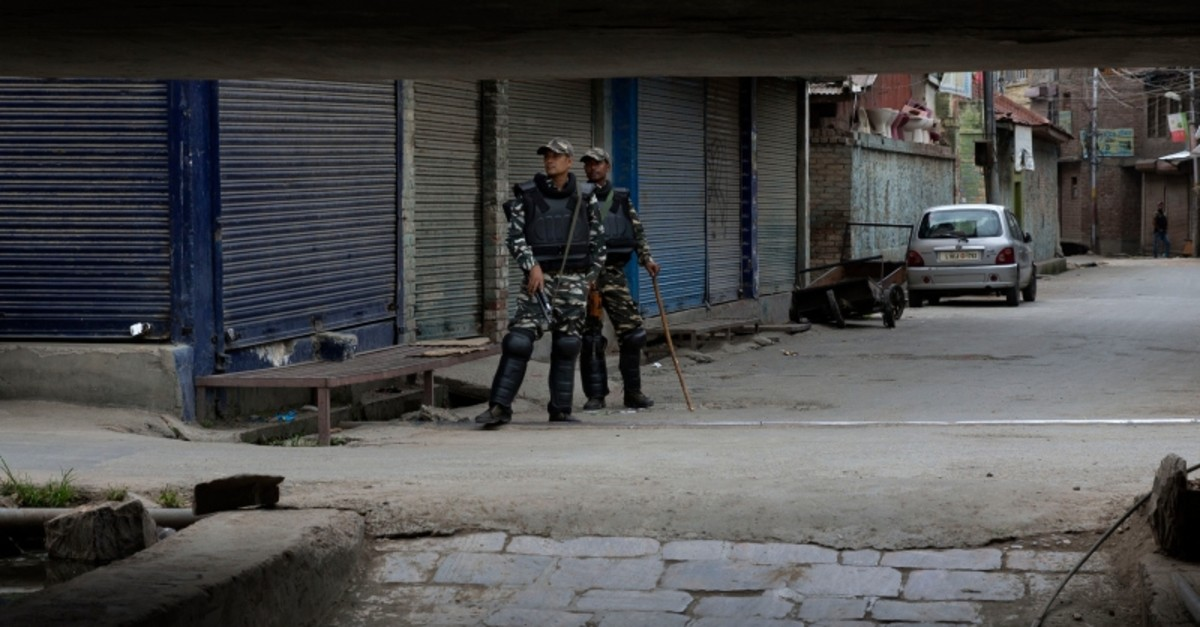 Indian paramilitary soldiers stand guard at a closed market in central Srinagar, Indian controlled Kashmir, Tuesday, Aug. 27, 2019. (AP Photo)