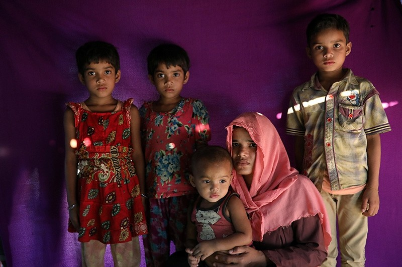 Marjan, whose husband was among 10 Rohingya men killed by Myanmar security forces and Buddhist villagers on Sept. 2, 2017, poses for a picture with her children at Thaingkhali camp in Cox's Bazar, Bangladesh, March 21, 2018. (Reuters Photo)