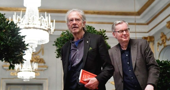 Peter Handke speaks at a press conference at the Swedish Academy in Stockholm, Friday, Dec. 6, 2019. (TT News Agency via AP)
