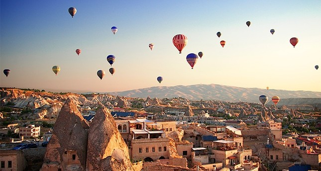 Sunrise in Cappadocia, Turkey, with balloons and typical fairy chimney (File Photo)
