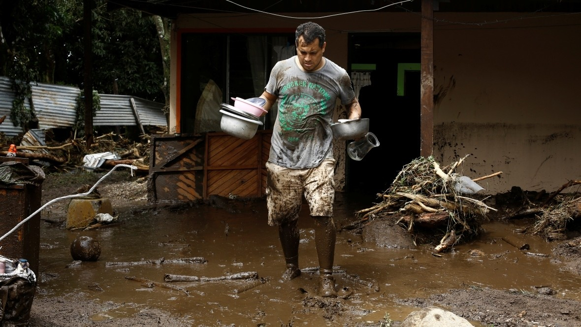 A man removes his belongings from his home damaged after Tropical Storm Otto hit in Guayabo de Bagaces, Costa Rica on Friday. (AFP Photo)