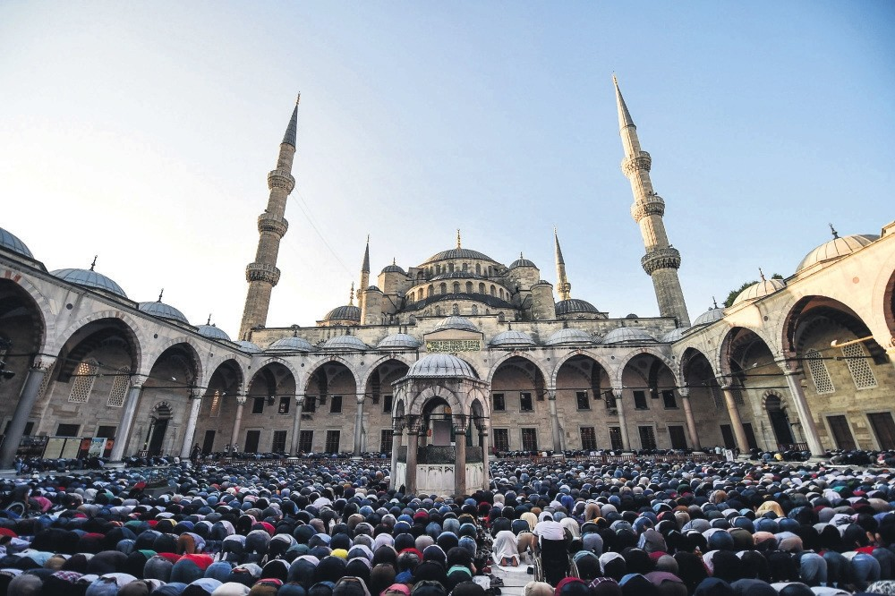 Muslim worshipers perform Eid al-Fitr prayers at the Sultan Ahmed Mosque (Blue Mosque), Istanbul, June 2017.