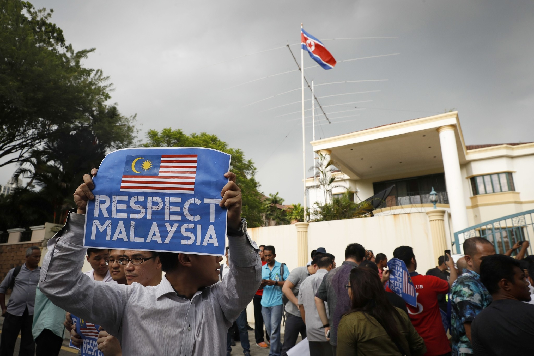 A members of the UMNO Youth holds a placard as they gather to protest against the killing of Kim Jong Nam outside North Korean Embassy in Malaysia, Thursday, Feb. 23, 2017. (AP Photo)