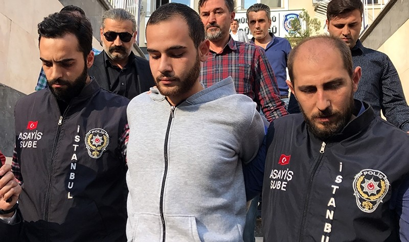 Ahmet Barakat (C) is being escorted by police to a vacation court, Istanbul, Turkey, Oct. 6, 2017. (AA Photo)