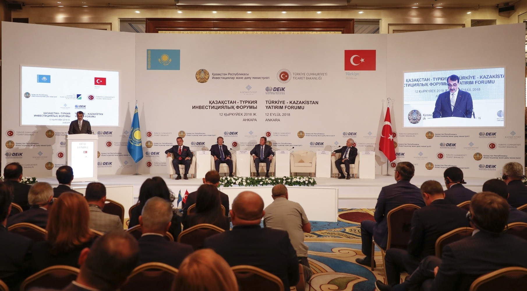 Energy and Natural Resources Minister Fatih Du00f6nmez (L) speaks during the Turkey-Kazakhstan investment forum in Ankara, Sept. 12.
