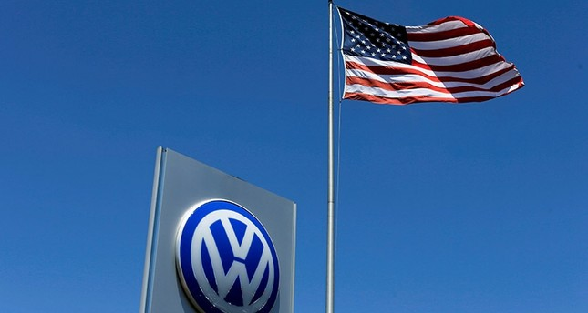 A U.S. flag flutters in the wind above a Volkswagen dealership in Carlsbad, California, U.S. May 2, 2016. (Reuters Photo)