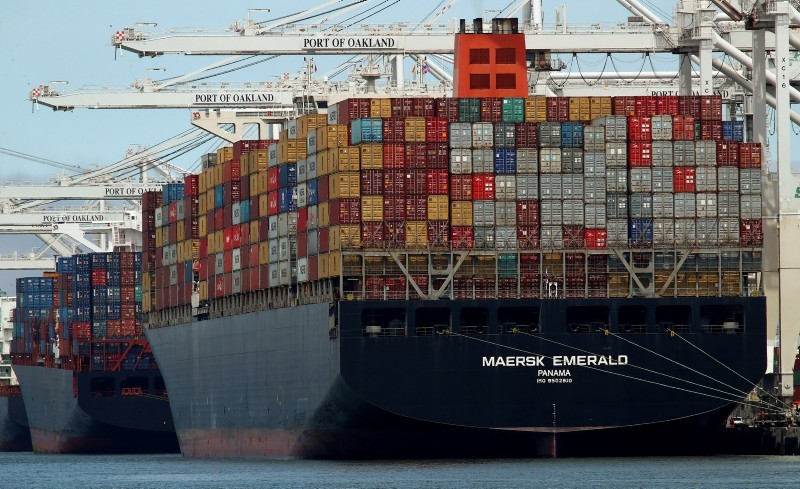 In this Thursday, July 12, 2018, file photo, the container ship Maersk Emerald is unloaded at the Port of Oakland, Calif. (AP Photo)