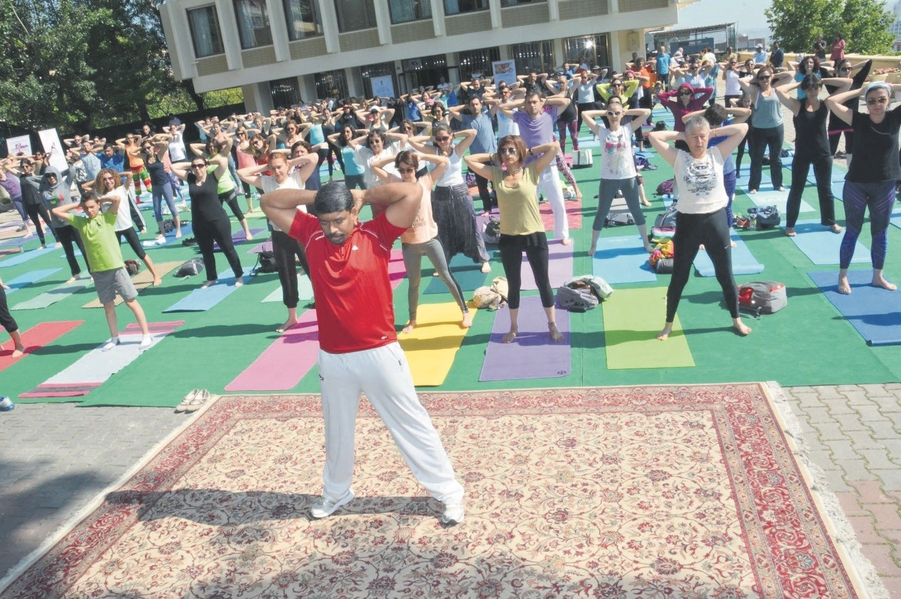 People attending open-air yoga session Wednesday to celebrate International Yoga Day.