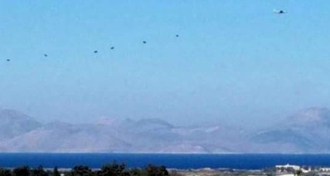 Photo obtained from social media shows Greek paratroopers landing on the Island of Kos.