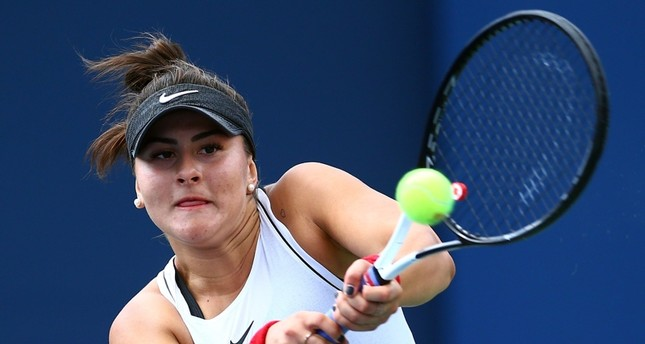 Bianca Andreescu of Canada hits a shot against Sofia Kenin of the United States during a semifinal match on Day 8 of the Rogers Cup at Aviva Centre on Aug. 10, 2019 in Toronto (AFP Photo)