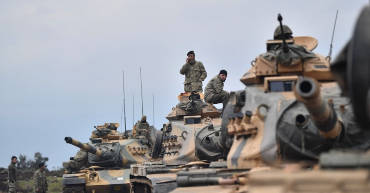 Turkish army soldiers gather with tanks as they wait near the Syrian border before entering neighbouring Syria on January 21, 2018 at Hassa, in Hatay province. (AFP File Photo)