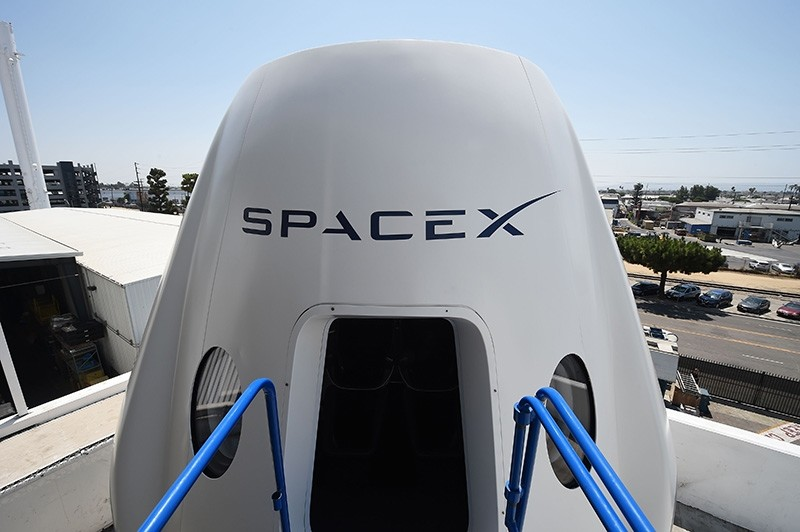 In this file photo taken on August 13, 2018 a mock up of the Crew Dragon spacecraft is displayed during a media tour of SpaceX headquarters and rocket factory in Hawthorne, California. (AFP Photo)
