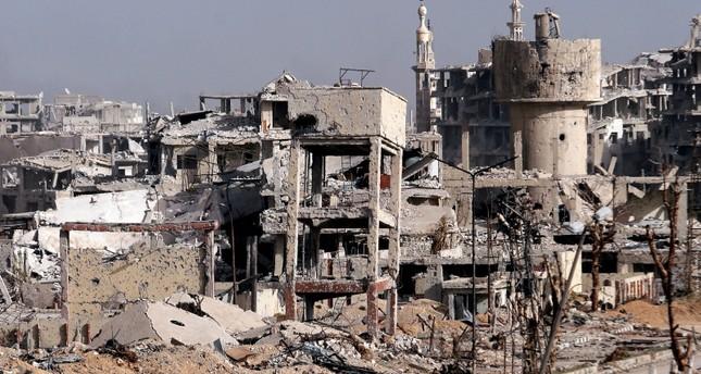 الدمار في ضواحي دمشق (رويترز)