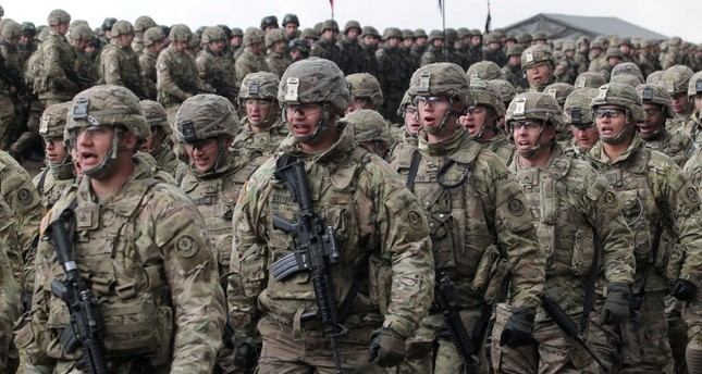 Soldiers of the 2nd Armored Cavalry Regiment of the US Army during welcome ceremony of the NATO Enhanced Forward Presence (eFP) contingent in the Military Training Center of the Land Forces in Orzysz, northern Poland, April 13, 2017. (EPA Photo)