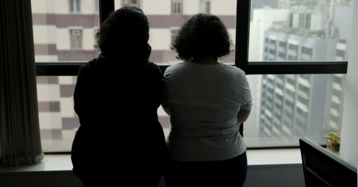 Sisters from Saudi Arabia, who go by aliases Reem and Rawan, are pictured at an office in Hong Kong, China February 23, 2019. (Reuters Photo)