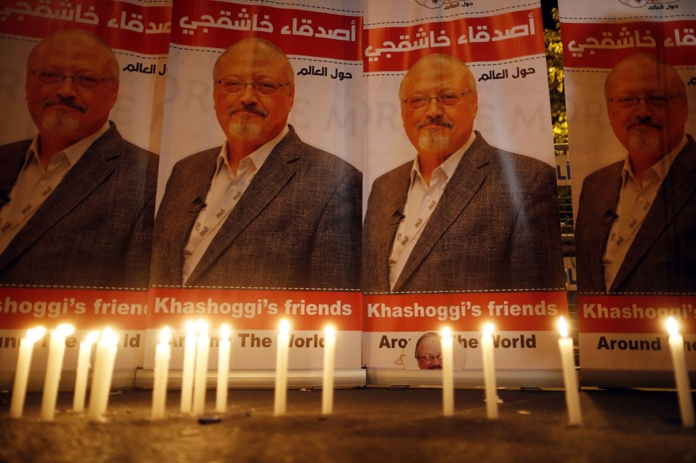Candles lit by activists, protesting the killing of Saudi journalist Jamal Khashoggi, are placed outside Saudi Arabia's Consulate in Istanbul during a candlelight vigil, Oct. 25.