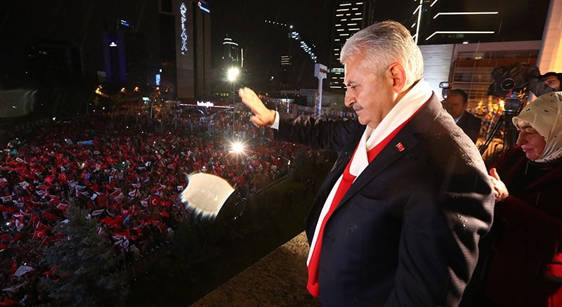 PM Binali Yu0131ldu0131ru0131m waves at 'Yes' campaign supporters gathered in front of the AK Party headquarters in Ankara, April 16, 2017. (AA Photo)