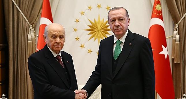 President Recep Tayyp Erdoğan (R) shakes hands with MHP Chairman Devlet Bahçeli. (AA Photo)