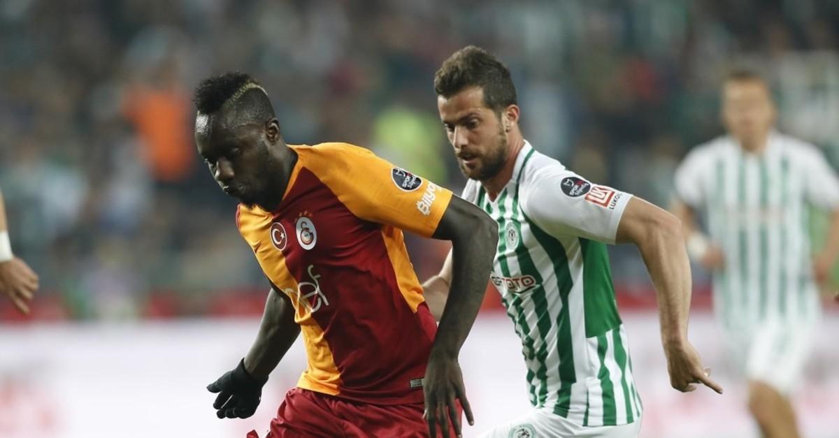 Galatasaray's Diagne chased by Konyaspor's Jahovic in Su00fcper Lig game, April 29, 2019.
