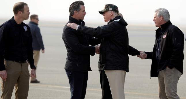 President Donald Trump greets California Gov.-elect Gavin Newsom as he arrives on Air Force One at Beale Air Force Base for a visit to areas impacted by the wildfires, Saturday, Nov. 17, 2018. (AP Photo)