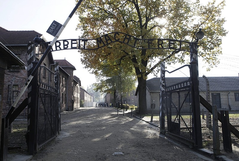 In this Oct. 19, 2012 file photo the entrance with the inscription ,Arbeit Macht Frei, (Work Sets You Free) gate of the former German Nazi death camp of Auschwitz is pictured at the Auschwitz-Birkenau memorial in Oswiecim, Poland. (AP Photo)