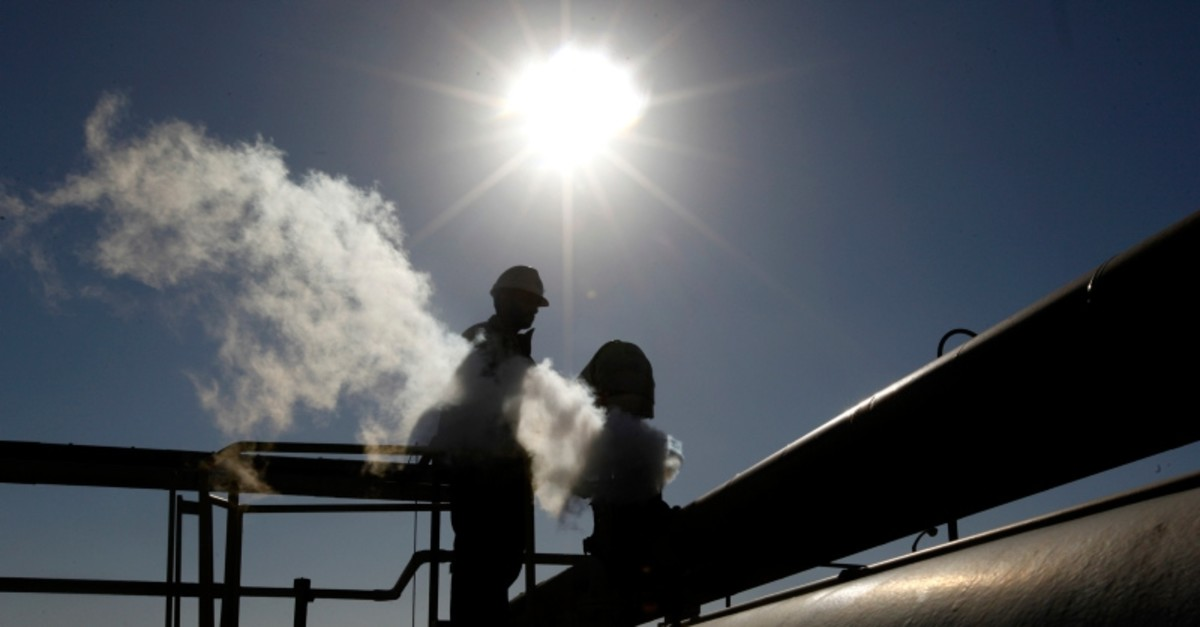 In this Feb. 26, 2011 file photo, a Libyan oil worker, works at a refinery inside the Brega oil complex, in Brega, eastern Libya. (AP Photo)