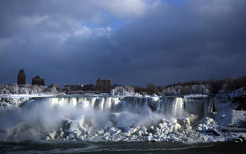 Water flows over the American Falls as ice forms in this view from the Canadian side in Niagara Falls, Ont., Tuesday, Jan. 2, 2018. (AP Photo)