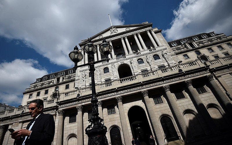 A man stands outside the Bank of England in the City of London, Britain April 19, 2017. (Reuters Photo)