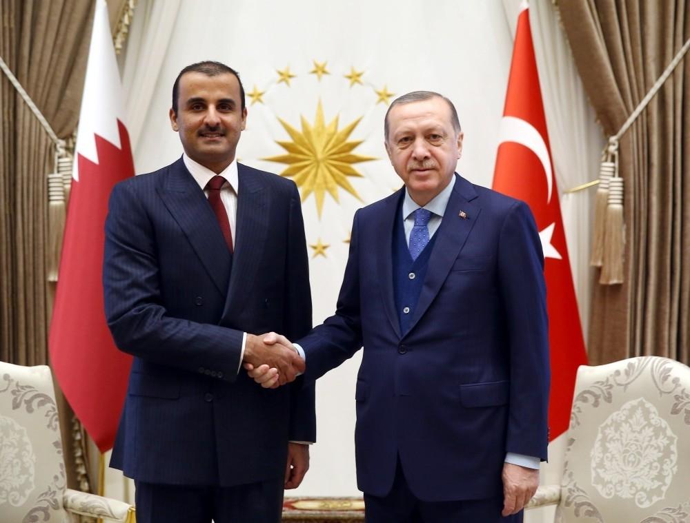 Emir of Qatar Sheikh Tamim bin Hamad Al Thani (L) shakes hands with President Recep Tayyip Erdou011fan, Ankara, Jan.15.