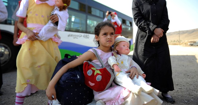 Girls that were evacuated from the besieged Damascus suburb of Daraya arrive to a camp inside Herjalleh suburb of Damascus, August 27, 2016. (REUTERS Photo)