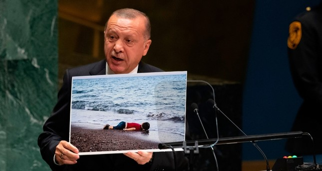 President Recep Tayyip Erdogan holds up a photo as he speaks during the 74th Session of the United Nations General Assembly at UN Headquarters in New York, Sept. 24, 2019. AFP Photo