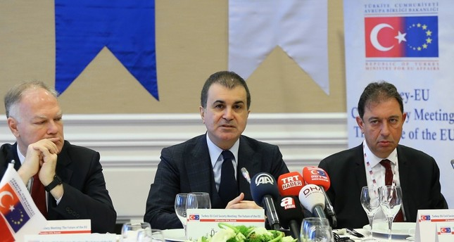 EU Minister Ömer Çelik in Brussels with the members of the press during his visit on Nov 29.