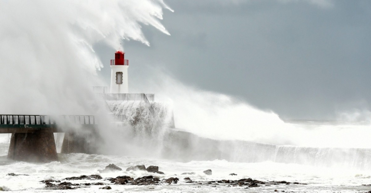 Large waves hit the lighthouse which guides to the entrance of the harbour in Les Sables-d'Olonne, western France. (AFP Photo)